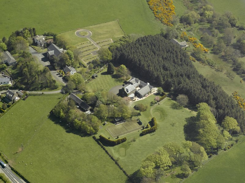 Oblique aerial view centred on Glebe house, taken from the NW.