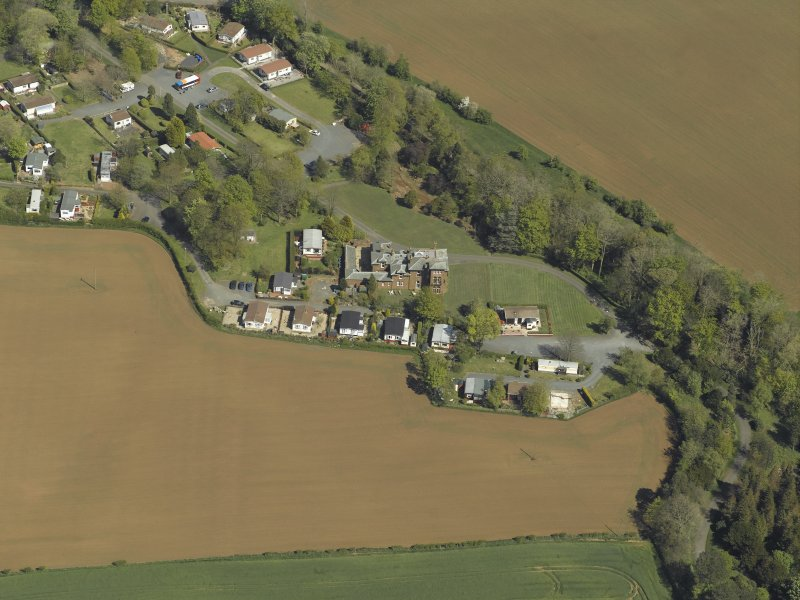 General oblique aerial view centred on the house, with caravan site adjacent, taken from the WSW.