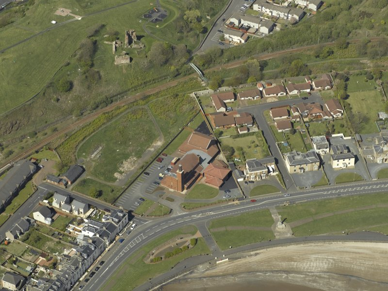 Oblique aerial view centred the Church with the remains of Ardrossan Castle adjacent, taken from the S.