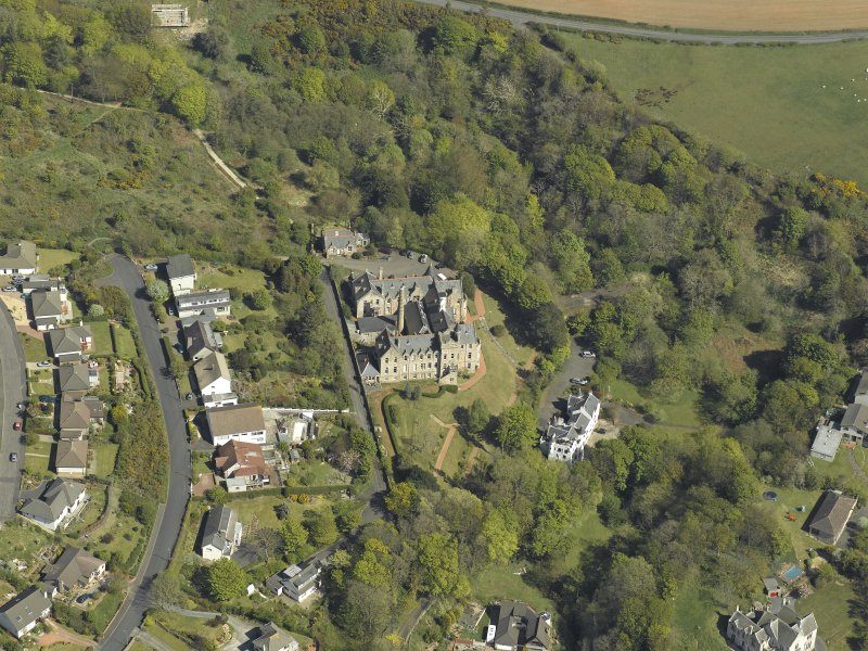 Oblique aerial view centred on the house, taken from the NNW.