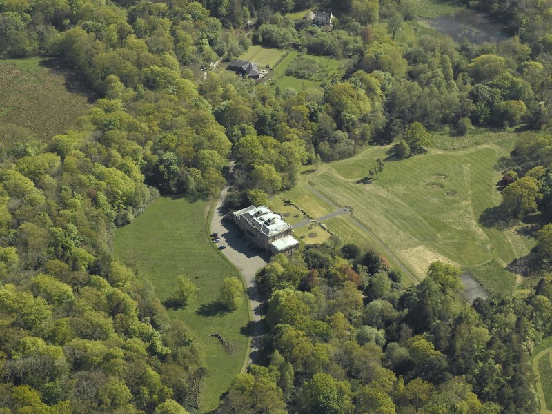 Oblique aerial view centred on the country house, taken from the NNW.