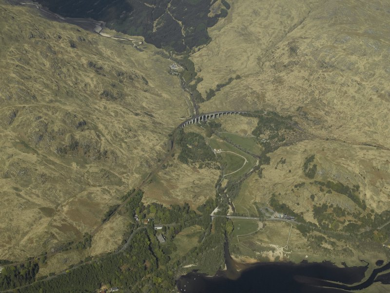 General oblique aerial view looking towards Glen Finnan centred on the railway viaduct  with the Monument adjacent, view from SW.