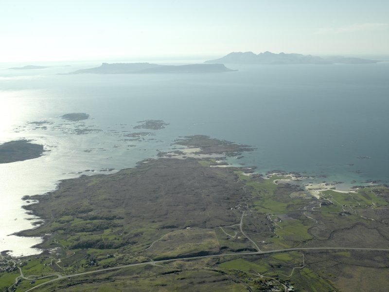 General oblique aerial view looking towards the Keppoch Peninsula and the distant Islands of Rum and Eigg centred on Back of Keppoch farmstead, taken from the E.