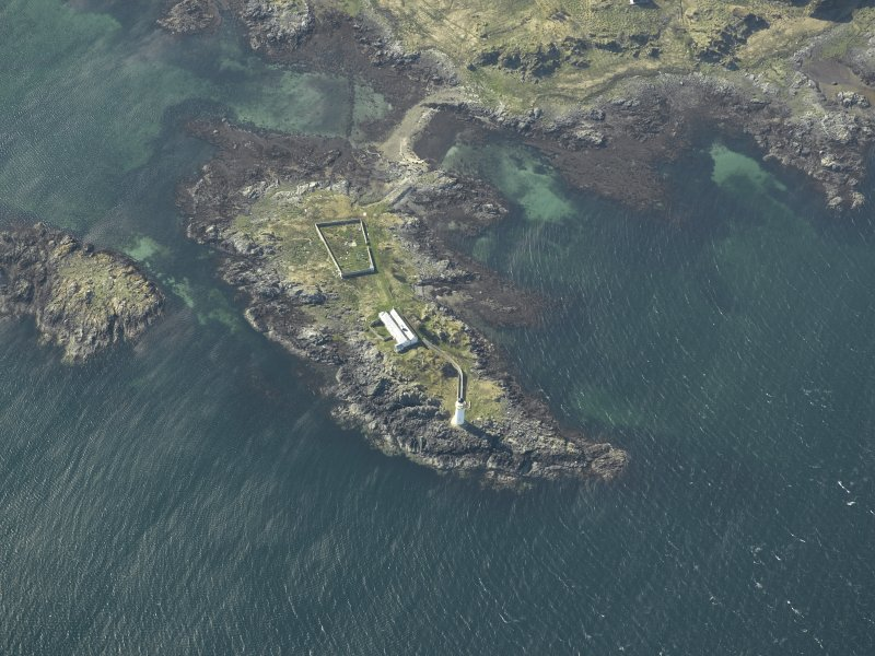 Oblique aerial view centred on Oronsay Lighthouse, Skye with the adjacent cottages, taken from the E.