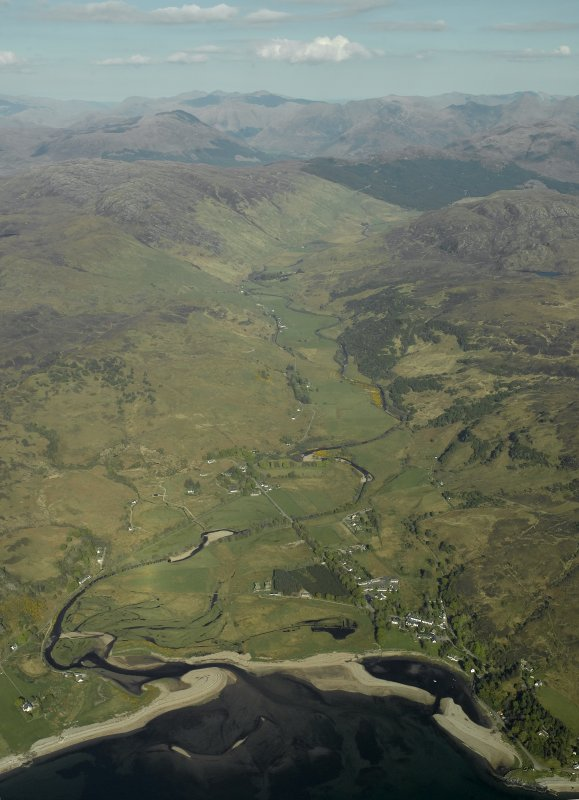 General oblique aerial view looking towards Glen More centred on the remains of the Barracks and the adjacent modern village, taken from the W.