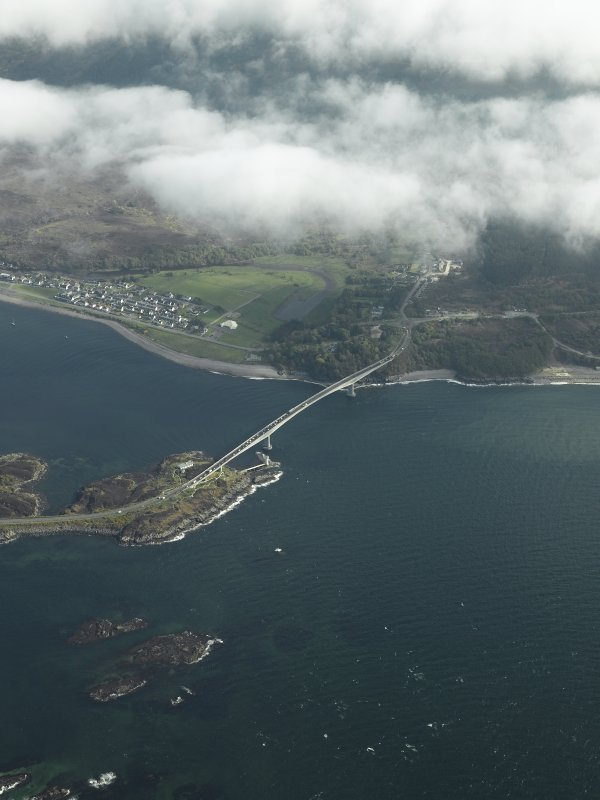 Oblique aerial view centred on the main span of the road bridge with the adjacent village of Caol Acain (Kyleakin), taken from the N.
