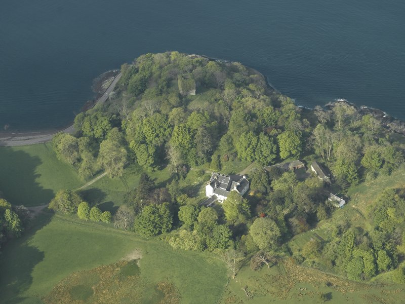 Oblique aerial view of the country house and the remains of the castle, taken from the ENE.
