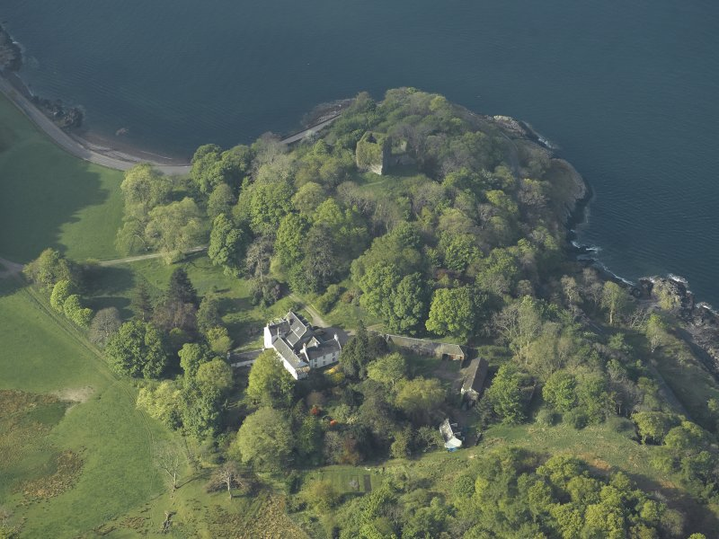 Oblique aerial view of the country house and the remains of the castle, taken from the NE.