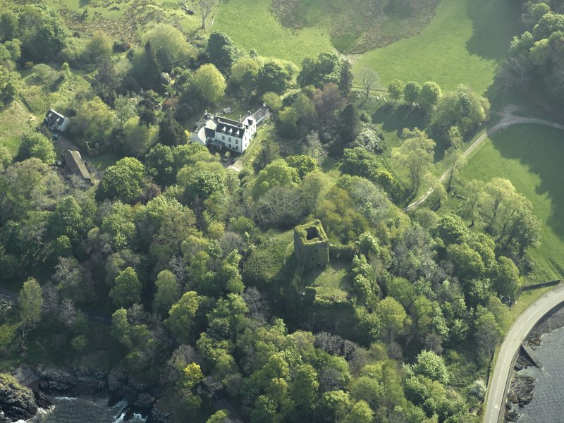 Oblique aerial view of the country house and the remains of the castle, taken from the S.