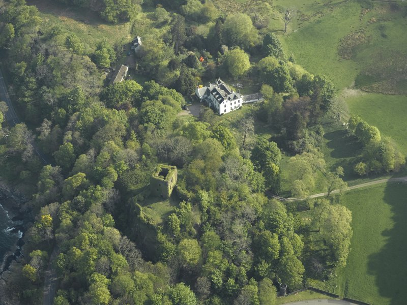 Oblique aerial view of the country house and the remains of the castle, taken from the SW.