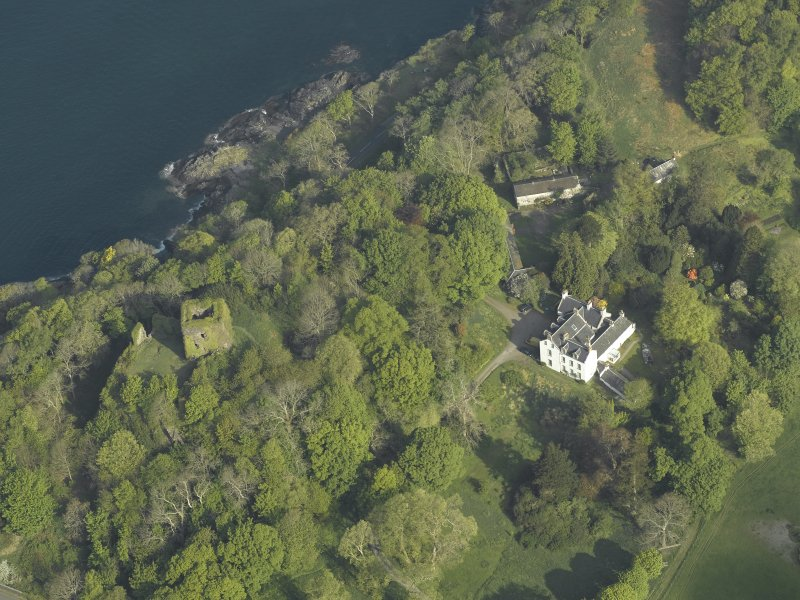 Oblique aerial view of the country house and the remains of the castle, taken from the SE.