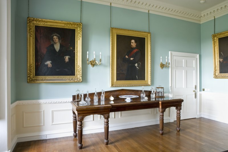 Interior. Ground floor, dining room, detail of side table and portraits