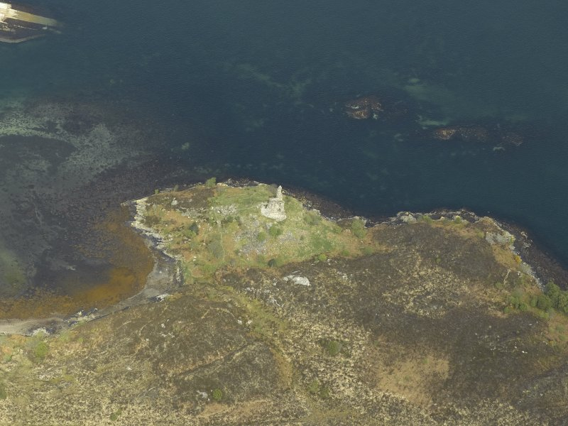 Oblique aerial view centred on the remains of the towerhouse, taken from the S.