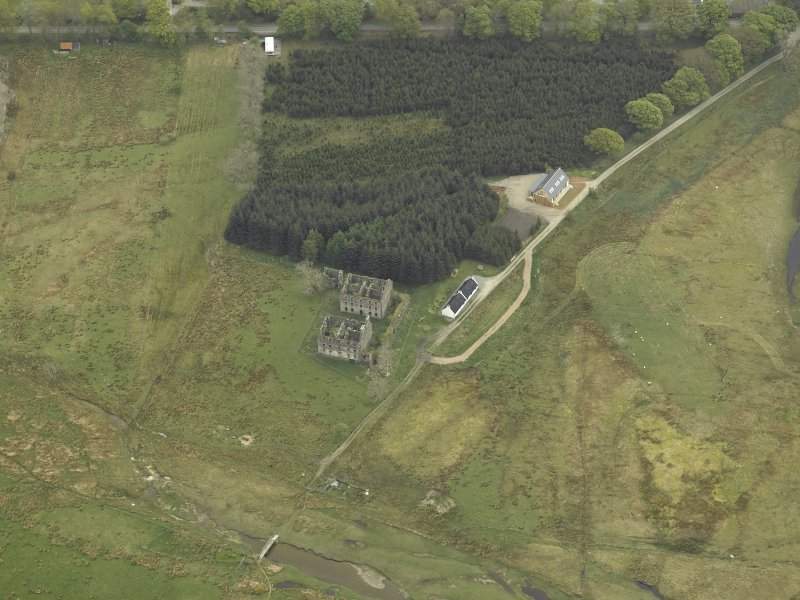 Oblique aerial view centred on the ruins of the barracks, taken from the NNW.