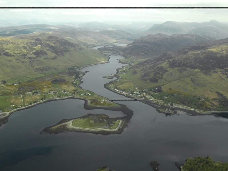 General oblique aerial view looking along Loch Long centred on the road bridge with the castle and village adjacent, taken from the SW.