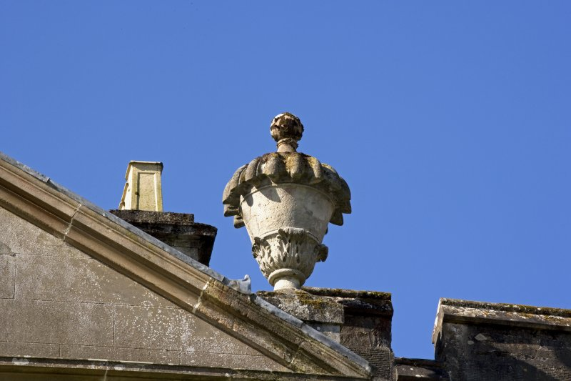 Detail of urn finial on pediment.