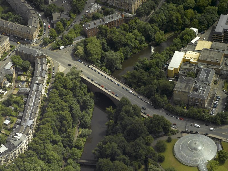 Oblique aerial view centred on the bridge with Kibble Palace adjacent, taken from the NW.