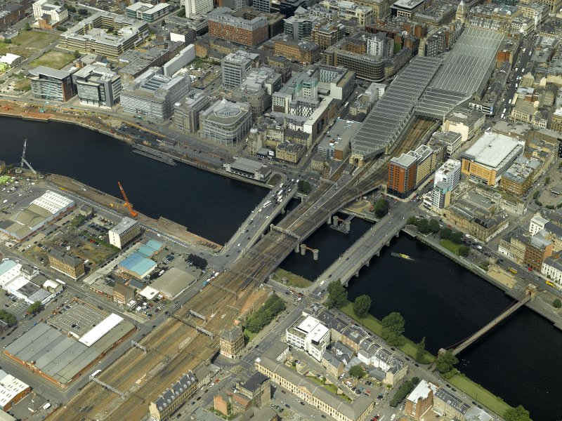 Oblique aerial view centred on the railway bridge and road bridges, taken from the NNE.