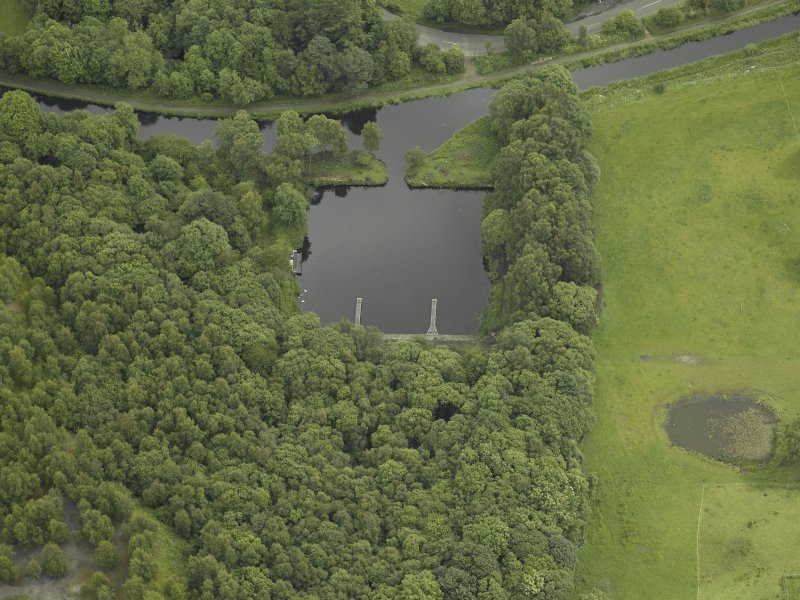 Oblique aerial view centred on the basin and canal, taken from the SW.