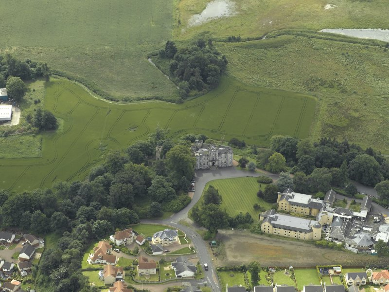 Oblique aerial view centred on the country house, taken from the N.