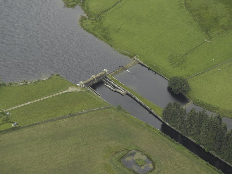 Oblique aerial view centred on the sluice and fish ladder, taken from the E.