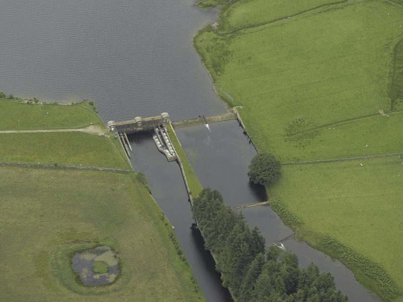 Oblique aerial view centred on the sluice and fish ladder, taken from the NE.