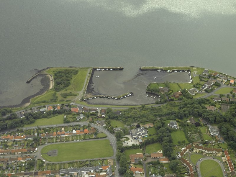 Oblique aerial view centred on the harbour, taken from the N.