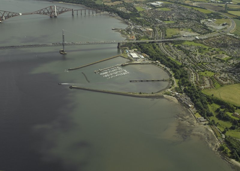 General oblique aerial view looking towards the Forth Bridge and Forth Road Bridge centred on the former Royal Naval Base, taken from the W.