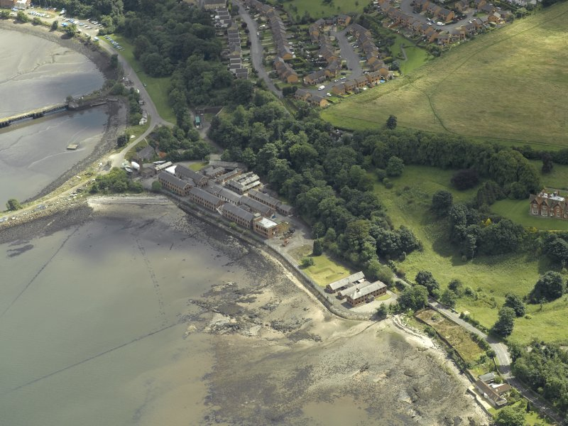 Oblique aerial view centred on part of the former Royal Naval Base, taken from the WNW.