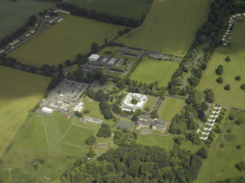 General oblique aerial view centred on the HQ building with Craigiehall house, barracks and married quarters adjacent, taken from the SW.