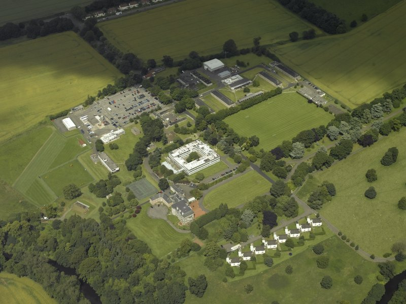 Oblique aerial view centred on the HQ building with Craigiehall House, barracks and married quarters adjacent, taken from the SW.