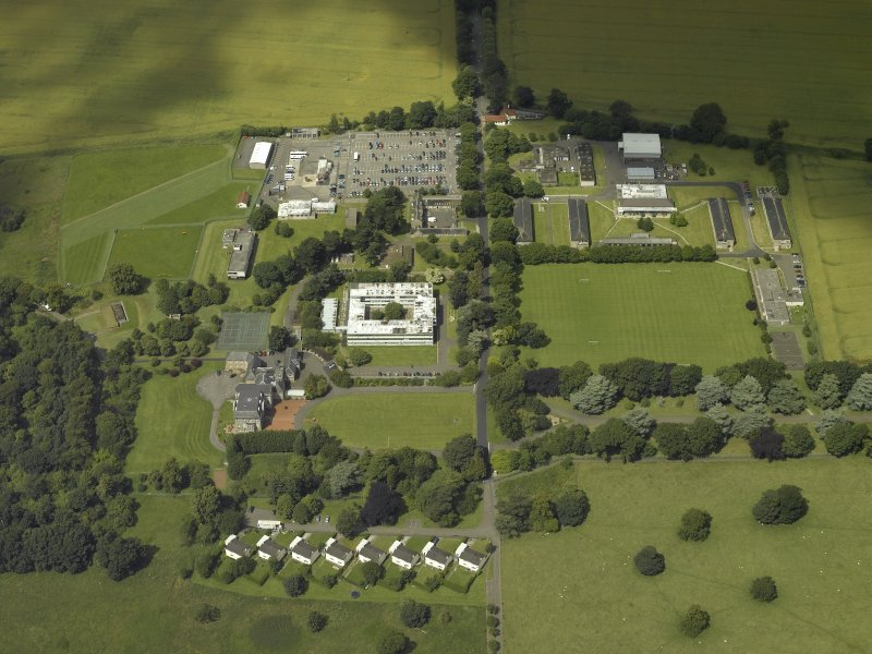 Oblique aerial view centred on the HQ building with Craigiehall house, barracks and married quarters adjacent, taken from the SE.