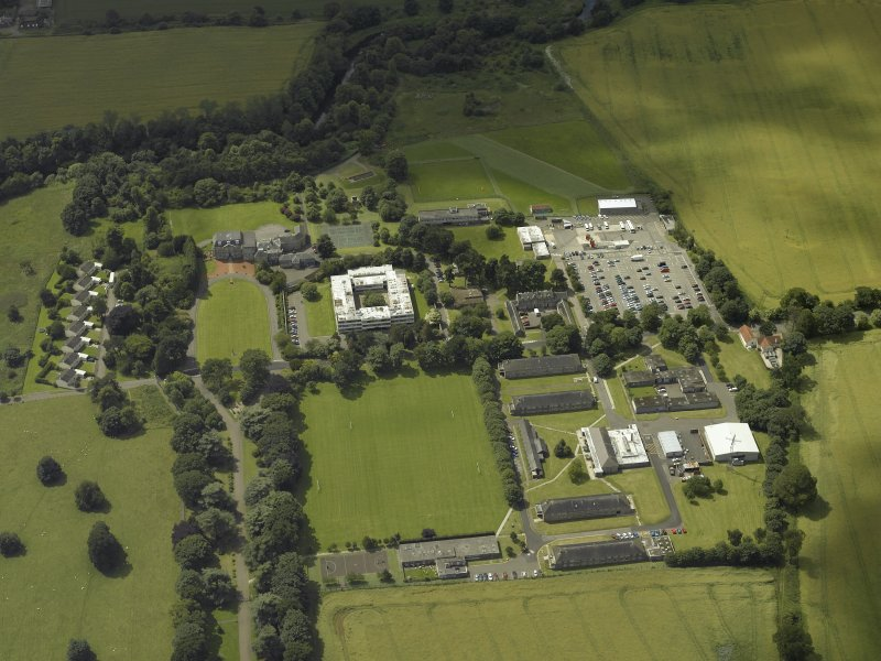 Oblique aerial view centred on the HQ building with Craigiehall house, barracks and married quarters adjacent, taken from the ENE.