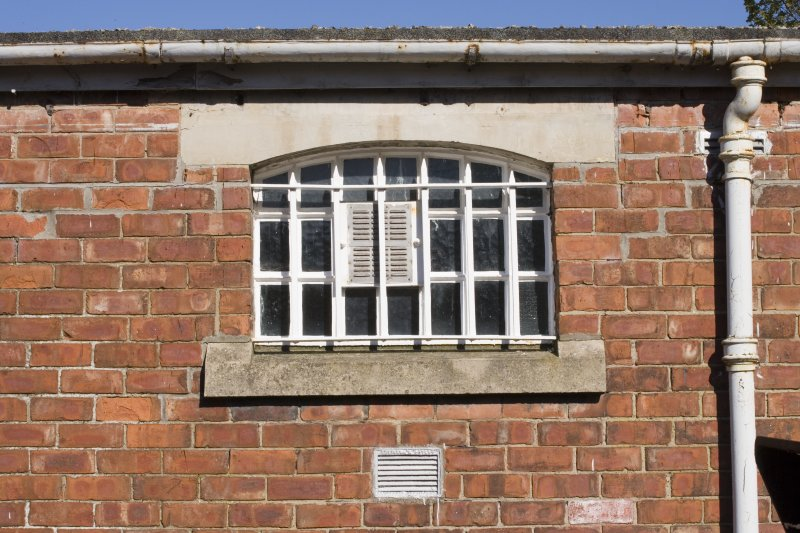 Detail.  Exterior view of cell window with iron bars.