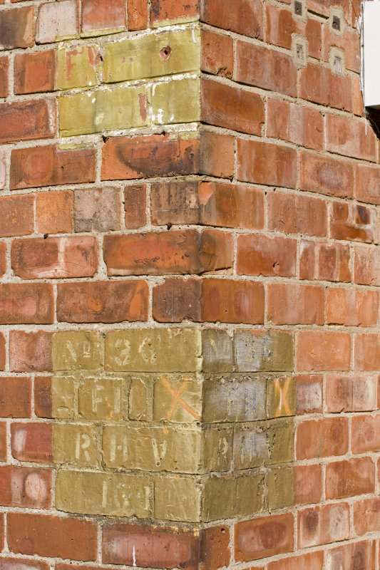 Detail.  Showing faded painted signs on wall of NE corner of wardroom block.