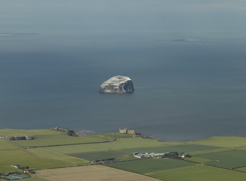 General oblique aerial view of the Bass Rock with Tantalon Castle adjacent, taken from the S.