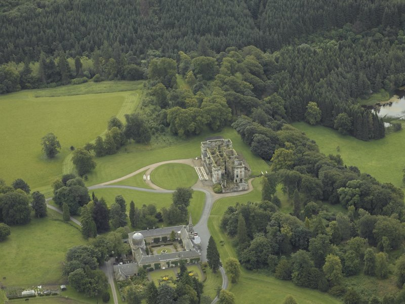 Oblique aerial view centred on the stables and the ruins of the house, taken from the NNW.