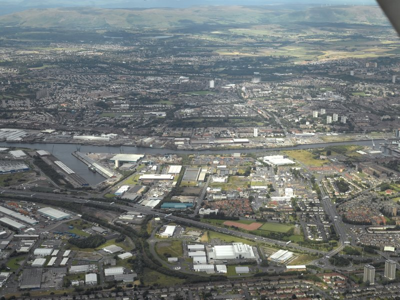 General oblique aerial view centred on the dock and the industrial estates, taken from the SSW.