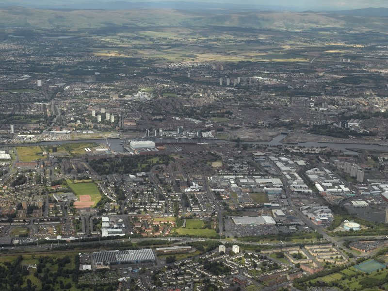General oblique aerial view centred on the shipyard and industrial estates, taken from the SSW.
