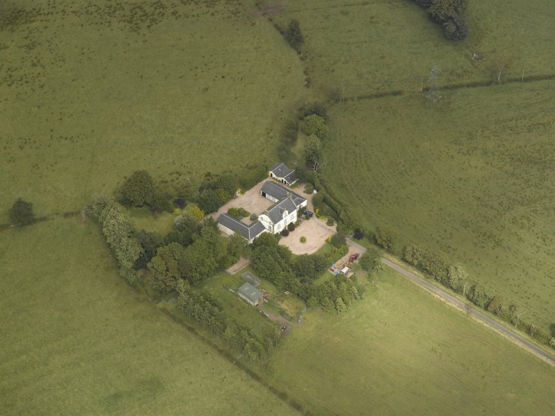 Oblique aerial view centred on the farmsteading, taken from the SSW.