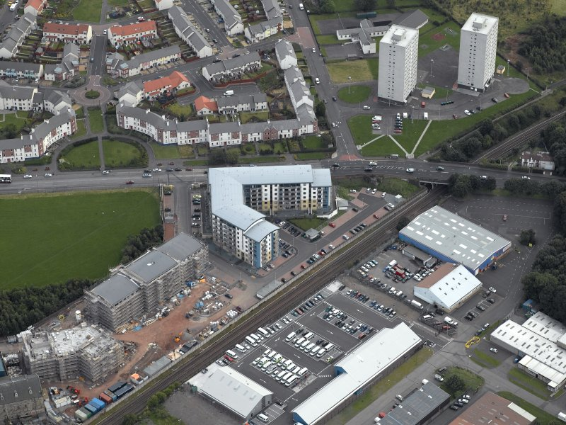Oblique aerial view centred on Drybrough Crescent showing second phase of new housing development under construction, taken from the NNW.