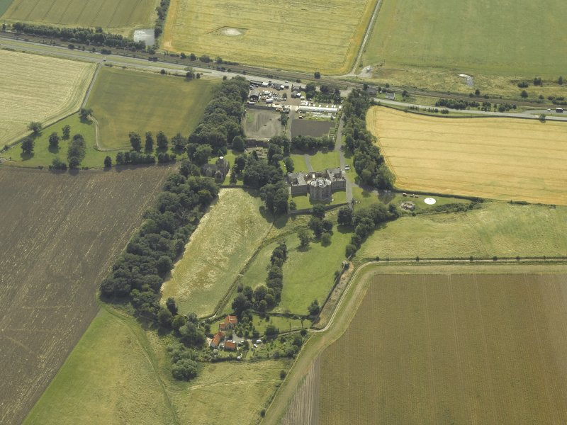 General oblique aerial view centred on the house, taken from the NNW.