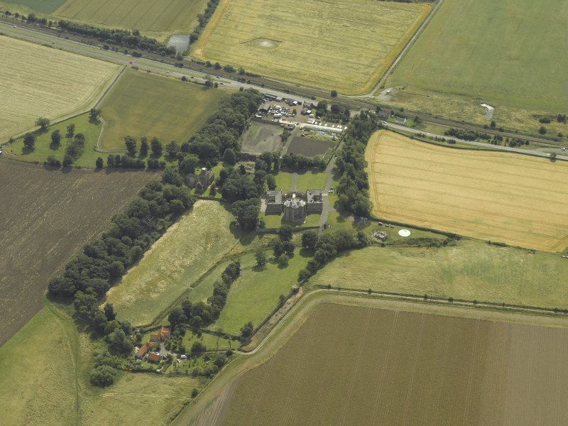 General oblique aerial view centred on the house, taken from the NW.