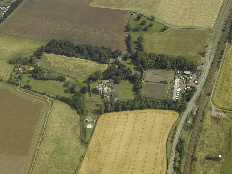 General oblique aerial view centred on the house, taken from the SW.