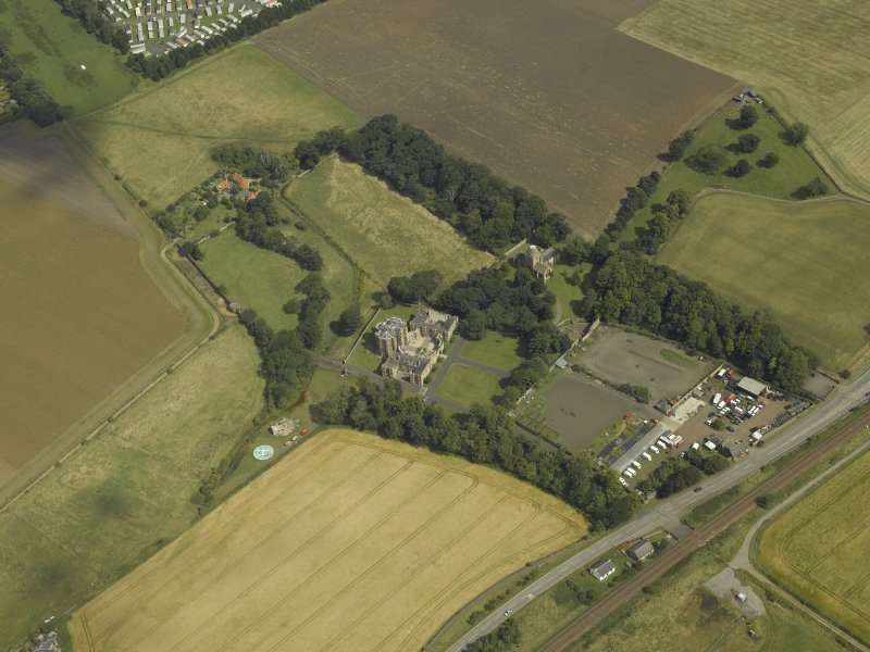 General oblique aerial view centred on the house, taken from the SSW.