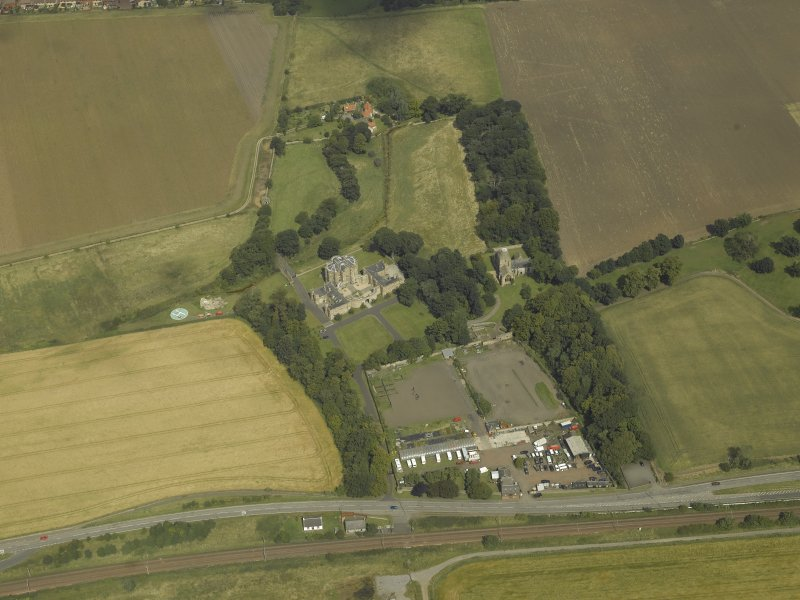 General oblique aerial view centred on the house, taken from the S.