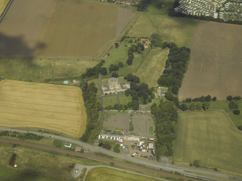General oblique aerial view centred on the house, taken from the SSE.