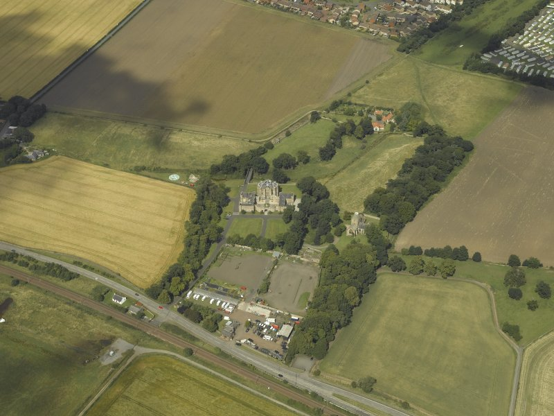 General oblique aerial view centred on the house, taken from the SE.