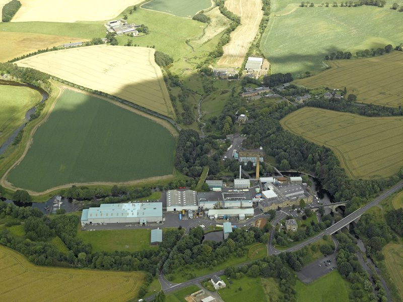 Oblique aerial view centred on the paper mill, taken from the S.