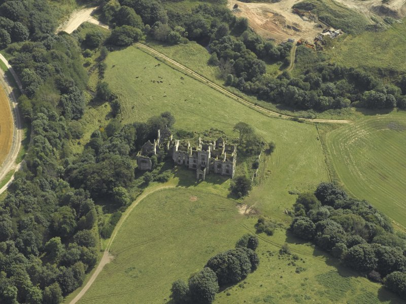 Oblique aerial view centred on the ruins of Ury House, taken from the NW.